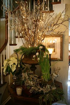 I like the tall vase with tall branches in the stair corner idea.  Romancing the Home: Christmas Details from Jill's Home
