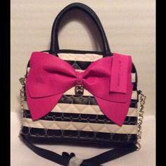 "Betsey Johnson Bow Dome Satchel NWT Betsey Johnson Bow Dome Satchel. Black/White/Pink. Inside slip pocket, 1 zipper pocket. Dual handles,  removable adjustable shoulder strap. 13"" x 9.5"" NWT Betsey Johnson Bags Satchels"
