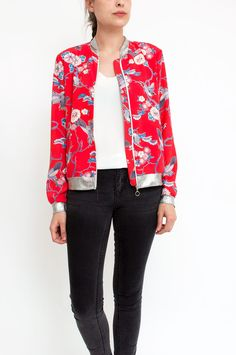 This red bomber jacket is a feminine take on a casual classic. Printed in a beautiful floral/bird print, the slim silhouette features a silver-tone zip fastening and silver rib trim detailing. We're wearing ours over city-chic ensembles. From Sienna With Love. Available at Sienna & Faye.