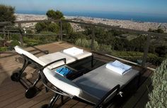 The hotel sits on top of the Tibidabo Mountain, the highest vantage point of Barcelona. Gran Hotel, Sit On Top, Outdoor Furniture, Outdoor Decor, Sun Lounger, Conference Room, Barcelona, Table, Mountain