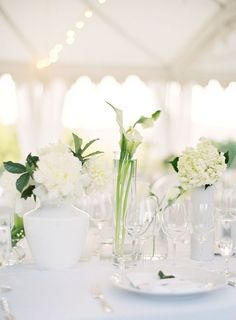white flowers + white + clear glass vases.