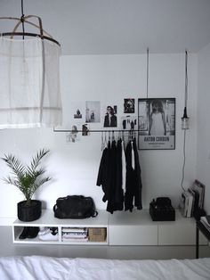 Minimalist, black & white interior.  Risingbarn.com  #black #white #small #space #design #modern #simple #chic