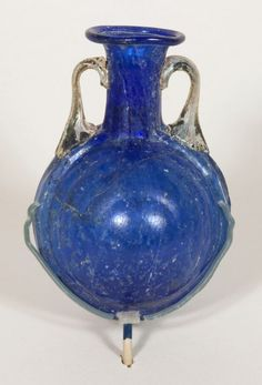 """1st AD Roman mold-blown glass bottle. 8 x 5.5 x 5.1 cm (3 1/8"""" x 2 1/8"""" x 2""""). Gift of Theodore W. and Frances S. Robinson, 1943.1170"""