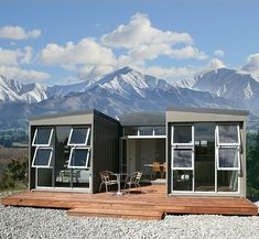 Three containers, used to build a sleep-out with a glass window wall in the valley of a mountain range