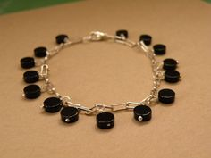 Eclipse       Black Onyx Wire Wrapped by ScorpionMoonDesigns, $78.00
