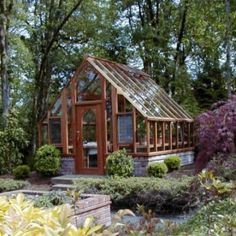 Someday we'll have a 12 X 12 Tudor Greenhouse like this in the backyard (sturdi-built greenhouses)