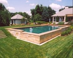 If your backyard isn't perfectly level, don't be afraid of a swimming pool – there are beautiful solutions to your problem! If your backyard isn't perfectly level, don't be afraid of a swimming pool – there are beautiful solutions to your problem! Sloped Yard, Sloped Backyard, Small Backyard Pools, Small Pools, Swimming Pools Backyard, Swimming Pool Designs, Pool Spa, Lap Pools, Indoor Pools