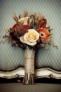 Fall wedding bouquet idea, with ivory rose, burgundy and burnt orange flowers, foliage, and grasses with lots of interesting texture. Description from pinterest.com. I searched for this on bing.com/images