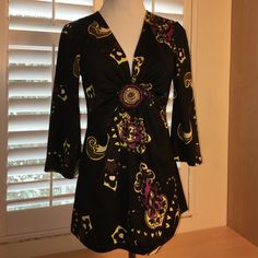 Inc low cut 3/4 sleeve Petite small.  Black with brown, beige, pink and yellow accent.  Embellishment (pictured) under bodice.  Low cut, very good condition. INC International Concepts Tops Blouses