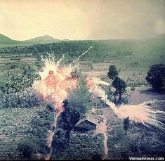 Napalm bombs explode on Viet Cong structures south of Saigon.