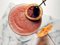 Our flavorful frozen drink of the day? It's a twist on the classic Blood and Sand, a Scotch-laced classic that always struck me as a little bit, well, tropical, thanks to fruity additions like orange juice and cherry brandy.