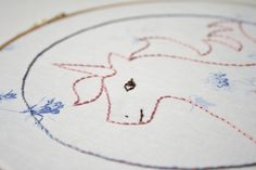 Unicorn embroidery design with free embroidery pattern to download. A great beginner embroidery project using backstitch.