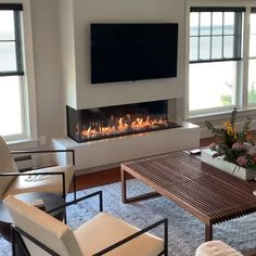 🔥🔥 Installed by August West Fireplace in gorgeous oceanfront home. Thanks to an incredible contractor, their talented carpenters and finish trades people this project was a complete success! Only with heat management technologies can you achieve this Living Room Decor Fireplace, Fireplace Tv Wall, Fireplace Remodel, Home Living Room, Living Room Designs, Corner Fireplaces, Fireplace Ideas, Living Room Electric Fireplace, Fireplaces With Tv Above