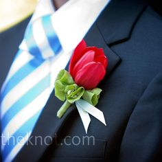 The groomsmen wore red tulip boutonnieres, which paired well with their blue and white striped ties.