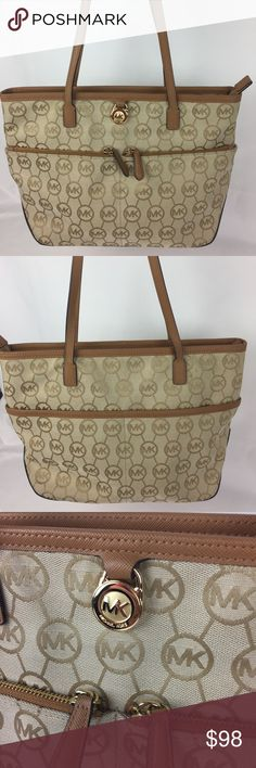 """MICHAEL KORS Camel Tan JACQUARD KEMPTON TOTE Condition Notes: Grade A- exterior needs cleaning. Interior : B needs cleaning.   MICHAEL Michael Kors' front-pocket tote flaunts a fabulous sense of style in signature jacquard with classic contrast trim and a highly functional interior. Double handles with 10"""" Drop. Top zip closure. 2 front exterior pockets. 1 zip and 3 slip interior pockets. 14"""" W x 9.5"""" H x 4.5"""" D   Thank you for your interest! No Trades please. Michael Kors Bags Totes"""