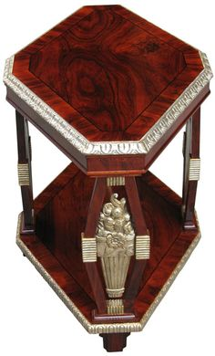 Rare octagonal Neo-Classically inspired French Art Deco side table with magnificent silver leaf relief decorations: stylized vases, flowers, birds, channeled panels and stiff leaf borders. Veneered with rosewood and inlaid with ebony. France, circa 1920's/30's. (hva)