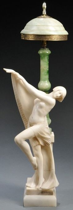 "LIGHTING ITALY,  Figural alabaster [table] lamp, Italy, early 20th century, with a green shade and stem mounted to a base with a carved female dancer, incised ""Prof. G. Bessi Italy"" Circa 1901-1920"