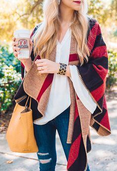 red plaid poncho with bell sleeve top and distressed skinny jeans