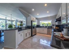The foyer w 20 ft high ceilings is elegant w marble flooring! High ceilings! Chefs kitchen w black granite, bay window & S/S appliances incl viking 6 burner stove, double oven, Kitchen Aid Frig & Soda fountain too!