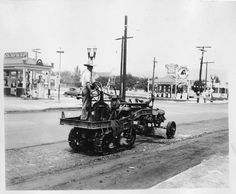Street work in Glendale, circa early 1920s. A Richfield gas station and a Gilmore Red Lion gas station are visible in the background. Glendale Central Public Library. San Fernando Valley History Digital Library.