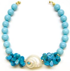 Helga Wagner Mother of Pearl turquioise color beads with Turquoise leaf teardrops and white Turbo Shell.
