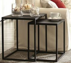 """Burke Nesting Side Table #potterybarn Crafted from blackened iron in simple cube shapes, our Burke tables have the bold character of industrial fixtures. The nesting tables are ideal for smaller spaces. Small: 17"""" square, 21.25"""" high Large: 20"""" square, 24.25"""" high Crafted of iron. Small table nests completely under large table. Finished in a matte black."""