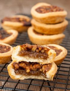 Maple Butter Tarts-flaky pastry tartlets filled with delicious maple custard, raisins and walnuts.