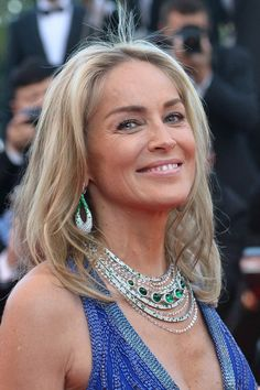 Sharon Stone made a statement in a large emerald and diamond necklace and matching earrings. #Cannes2013