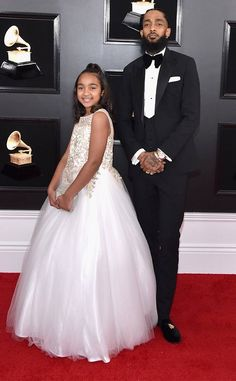 The Best Rap Album nominee attended the star-studded ceremony with his daughter.