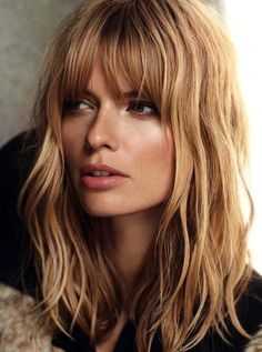 Midlength Shaggy Hair with Eye Grazing Bangs hairstyles