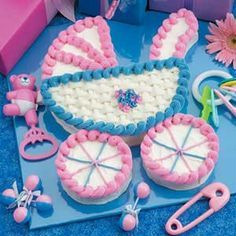 Baby Buggy Cake ~ A little one is on the way...that message will be clear as can be when you roll out this carriage confection for a baby shower! ~ Need a cake that serves more than 12 guests? Prepare two buggies—making one baby blue and one pink!