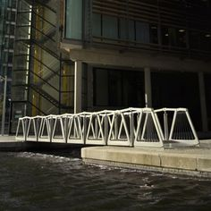 Rolling Bridge. This is really cool. I saw it in a TEDtalk he did in CA. The bridge actually rolls up from one side to another.