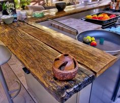 Have you ever thought of making your kitchen countertop out of wood? There are some great ways to design your kitchen with wooden countertops. This can give your kitchen a vintage look. Wood kitchen counters can also give you a Wooden Countertops, Outdoor Kitchen Countertops, Outdoor Kitchen Bars, Outdoor Kitchen Design, Granite Kitchen, Reclaimed Wood Kitchen, Primitive Kitchen, Wooden Kitchen, Diy Kitchen