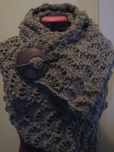 Free knitting Pattern on Ravelry. I think that is a hair accessory sort of pinning the scarf together. I like it, will need to figure out how to crochet