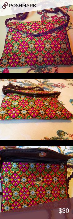 Beautiful crossbody purse Multicolored small crossbody purses with handmade braided type sling. Embroidered textile construction. Delicate and beautiful. Can carry iPhone 6 Plus, cards, cash and keys. Zipper top. Measurements: W 8xH 7xD 0.5 in. Sling drop 23 inches. Excellent condition. Used once. Boutique Bags Clutches & Wristlets