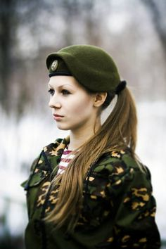 Russian army girl. Why can we wear pony tails again?