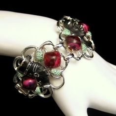 STRIKING! Fabulous vintage Egyptian Revival wide link bracelet with enameled figures and raspberry red stones. From http://stores.ebay.com/My-Classic-Jewelry-Shop #myclassicjewelry #vintagebracelet #egyptianbracelet #mummybracelet