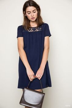 The cutest shift dress ever! This versatile navy baby doll shift dress features a delicate lace detail at the top. Great in the Summer with your favorite sandals, and cute in Fall with a pair of tight