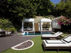 Fire Pit Design Ideas: This Hollywood regency-style home was once owned by the popular celebrity.  Maybe she used the sunken fire pit to keep her toes warm while she lounged and looked up at the stars.  From DIYnetwork.com