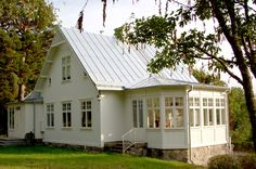 This veranda on the back looks like a great place to hang out. Swedish Cottage, Swedish House, Swedish Farmhouse, Future House, German Houses, This Old House, Cottage In The Woods, House Extensions, Scandinavian Home