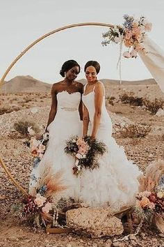 Romantic lesbian wedding ceremony with pampas grass and boho flowers | circular wedding installation for same sex marriage | Utterly Romantic Las Vegas Desert Elopement Inspo - Love Inc. Mag -JAMIE Y PHOTOGRAPHY Boho Flowers, Romantic Updo, Minimal Decor, Lesbian Wedding, Pampas Grass, Bride Look, Altars, Center Stage, Wedding Ceremony