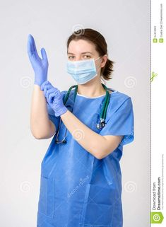 Photo about Female doctor putting on blue surgical gloves. Image of beautiful, medical, infection - 54410361 Images Of Gowns, Doctor Scrubs, Medical Photography, Nurse Stethoscope, Girl G, Female Doctor, Boys Wear, Rain Wear, Put On