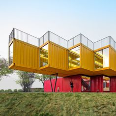Stacked shipping containers form temporary pavilion by Peoples Architecture Office