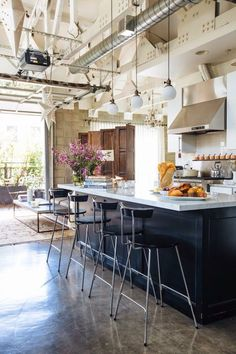 Industry Approved! LA Industrial Loft Modern Kitchen Mixed Media Brick Wood Bar Stools Island Lighting Trend Alert 2014 greyandscout.com