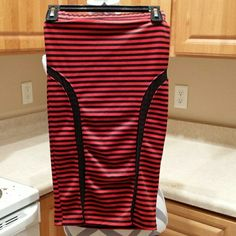 Red and black striped pencil skirt Red and black striped pencil skirt with mesh accents in the side. Fits true to size. Say Anything Skirts Pencil