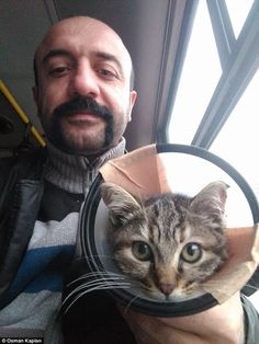 Mr Kaplan (pictured with Zeyna) makes cardboard houses for animals living on the streets o...