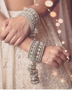 Our pick of the prettiest latest bangle designs and trends that real brides flaunted! Here's so many beautiful bangel designs for you to choose from! Indian Jewelry Sets, Indian Wedding Jewelry, Indian Bangles, Pakistani Jewelry, Bridal Bangles, Bridal Jewelry, Bridal Accessories, Diamond Jewelry, Silver Jewelry