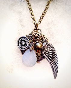 On Silver Wings Essential Oil Diffuser Necklace by OverYourHeart