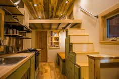 A custom-built tiny house on wheels in Laporte, Colorado. Built by Mitchraft Tiny Homes.