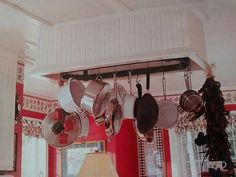 Pot rack inside of a built in.  Would be okay if pots were hung above stove and it also included a venting.  Do not like in the middle of the ceiling as shown.